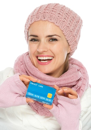 Happy woman in knit winter clothing showing credit card Stock Photo - 16467204