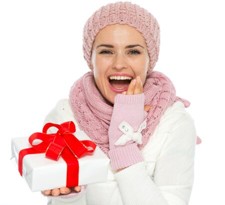 christmas present box: Surprised young woman in knit winter clothing holding Christmas present box Stock Photo