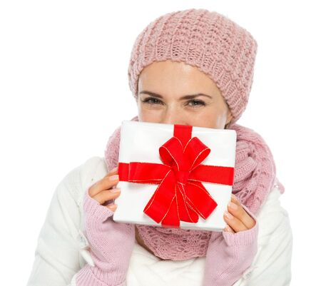 christmas present box: Happy woman in knit winter clothing hiding behind Christmas present box