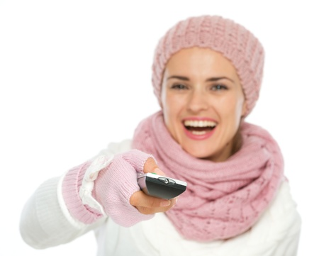 Closeup on TV remote control in hand of happy woman in knit winter clothing Stock Photo - 16467280