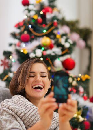 Happy woman near Christmas tree making self photo Stock Photo - 16467250