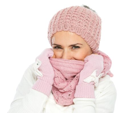 Woman in knit winter clothing closing face with knit scarf Stock Photo - 16467298