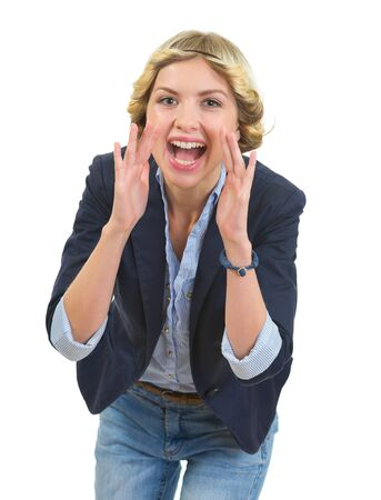 shaped hands: Smiling teenage girl shouting through megaphone shaped hands