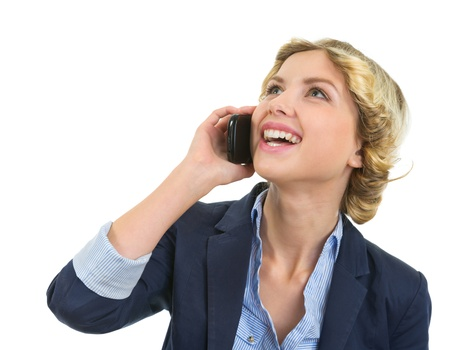 Portrait of smiling teenage girl talking mobile phone Stock Photo - 16515810