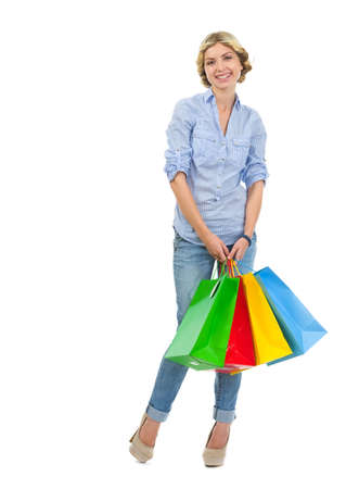 youthfulness: Happy teenage girl with shopping bags Stock Photo