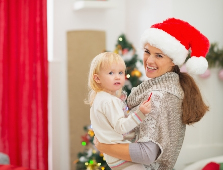 Portrait of mother and baby near Christmas tree Stock Photo - 16577986