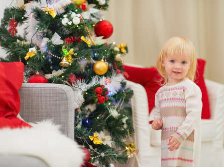 Portrait of baby girl near Christmas tree Stock Photo - 16578007