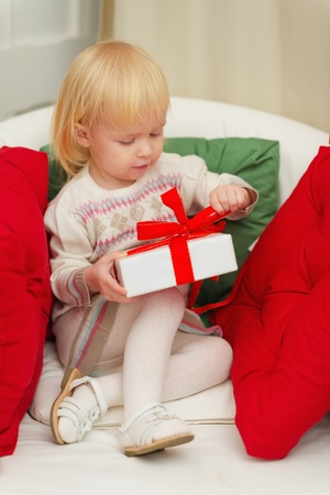 baby open present: Baby sitting on chair and open Christmas gift box