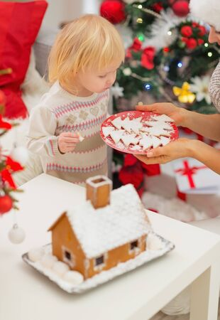Baby girl enjoying Christmas cookies Stock Photo - 16577976