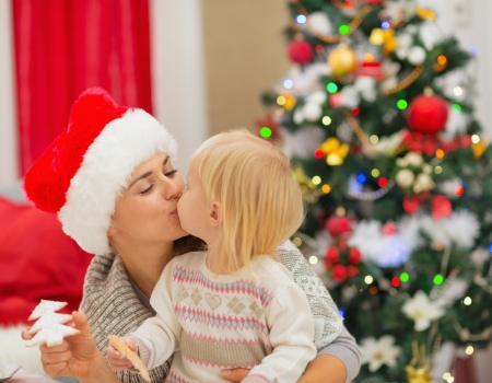 Mother and baby kissing near Christmas tree Stock Photo - 16577970