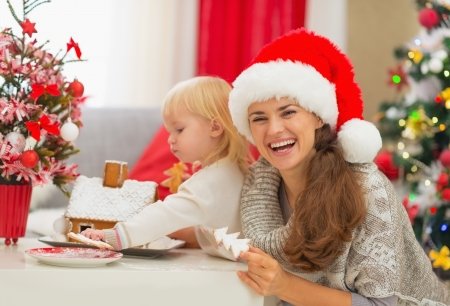 gingerbread house: Mother and baby enjoying Christmas cookies