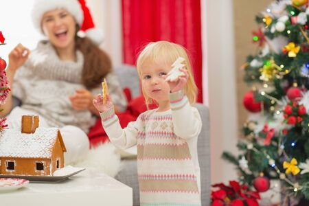 Baby girl enjoying Christmas cookies Stock Photo - 16577954