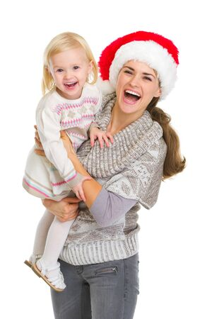 Christmas portrait of happy mother and baby girl Stock Photo - 16577981