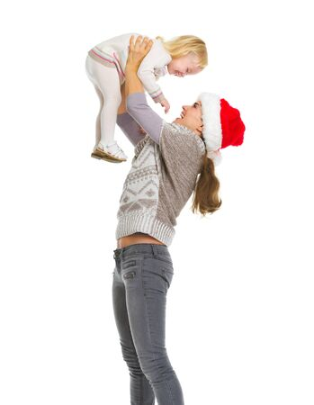 Christmas portrait of happy mother rising baby girl Stock Photo - 16577951