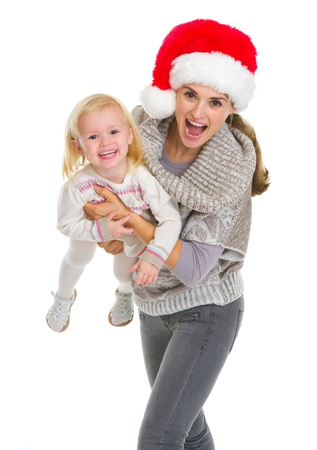 Christmas portrait of smiling mother playing with baby girl Stock Photo - 16577960