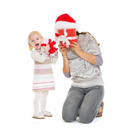 Mother and baby playing with Christmas present boxes Stock Photo - 16577935