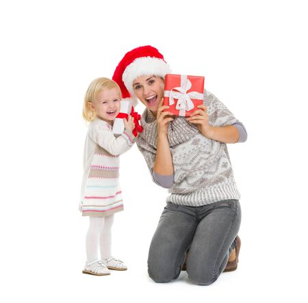 Mother and baby peekaboo from Christmas present boxes Stock Photo - 16577940