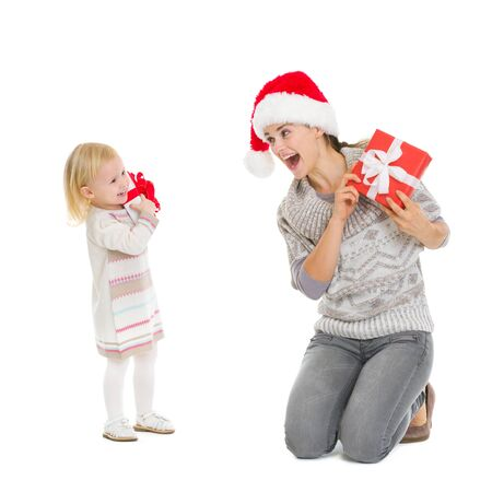 Happy mother and baby with Christmas present boxes photo