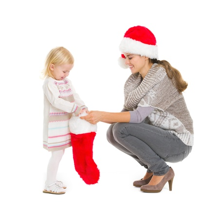 Baby girl taking out present from Christmas sock Stock Photo - 16577943