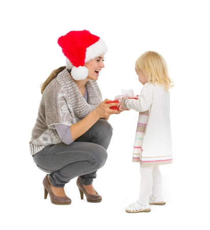 Happy mother making Christmas present to baby girl Stock Photo - 16577942