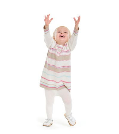 Baby girl in knit winter clothing pulling up to get something Stock Photo - 16577931
