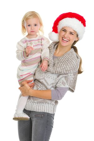 Christmas portrait of happy mother and eating cookie baby girl photo