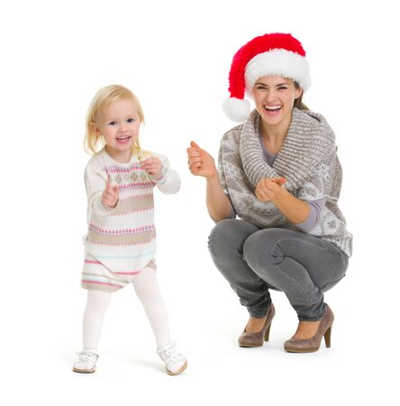 Christmas portrait of happy mother and baby girl dancing Stock Photo - 16577936