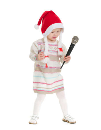 Baby girl in Christmas hat dancing with microphone Stock Photo - 16577933