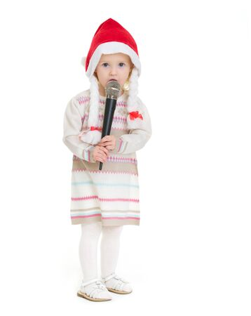 Baby girl in Christmas hat using microphone Stock Photo - 16577932