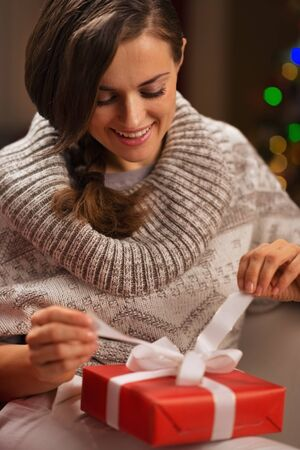 Happy young woman opening Christmas present box Stock Photo - 16710967