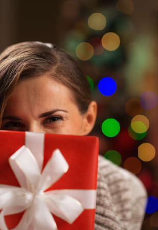Girl hiding behind Christmas present box Stock Photo - 16710996