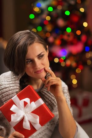Thoughtful young woman with Christmas present box Stock Photo - 16710966