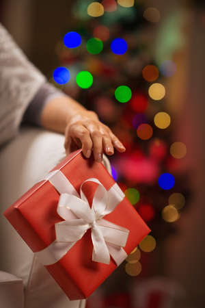 Closeup on Christmas present box in female hand Stock Photo - 16710958