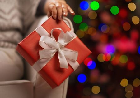 Closeup on Christmas present box in woman hand Stock Photo - 16710959
