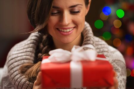 Happy young woman holding Christmas present box Stock Photo - 16711007