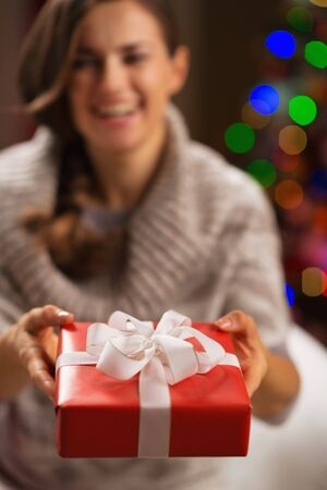 Closeup on Christmas gift box in woman hands Stock Photo - 16710990