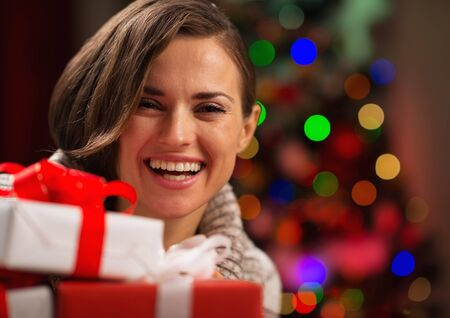 Happy young woman holding Christmas gift boxes Stock Photo - 16710988