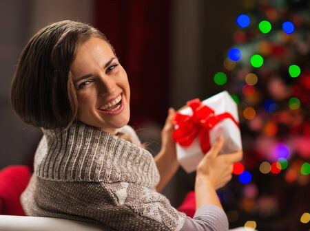 Happy young woman holding Christmas present box Stock Photo - 16710979