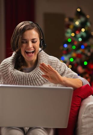 Happy young woman having video chat with family in front of Christmas tree Stock Photo - 16710965
