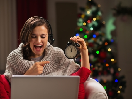 Happy young woman having video chat with family at New Year time Stock Photo - 16710991