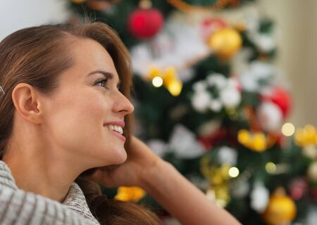 Portrait of smiling young woman near Christmas tree Stock Photo - 16720180