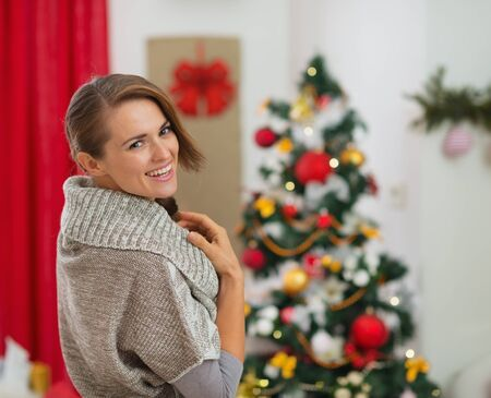 Portrait of happy young woman near Christmas tree Stock Photo - 16720169