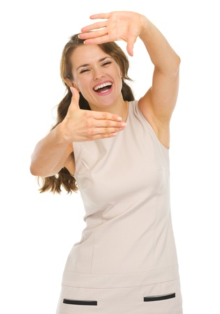 Happy young woman in dress framing with hands Stock Photo - 16882343