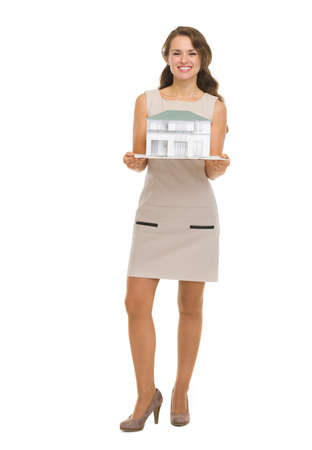 Happy woman homeowner showing scale model of house Stock Photo - 16882290