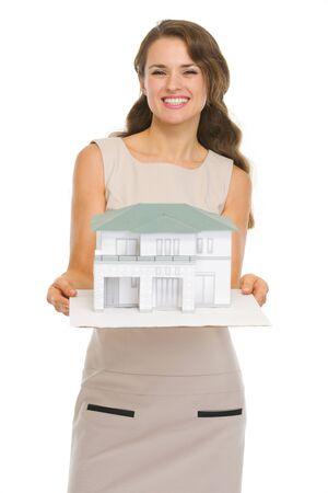 Smiling architect woman showing scale model of house Stock Photo - 16882341