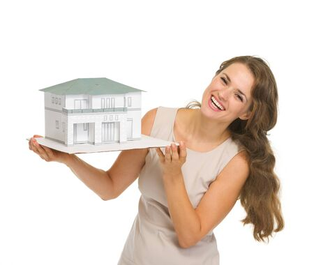 landlord: Smiling woman landlord with scale model of house