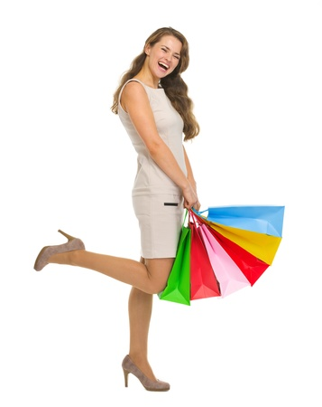 Smiling young woman in dress with shopping bags Stock Photo - 16882289