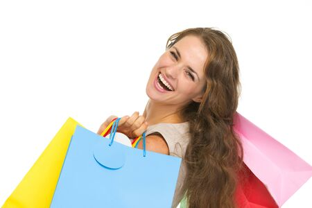 Portrait of smiling young woman with shopping bags Stock Photo - 16882354
