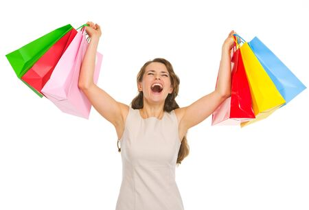 Happy young woman with shopping bags rejoicing success photo