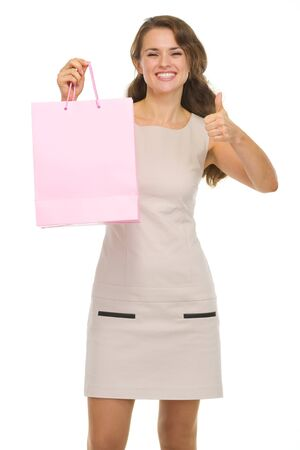 Happy young woman with shopping bags showing thumbs up Stock Photo - 16882280